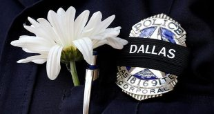 Dallas police officer wears a custom mourning band
