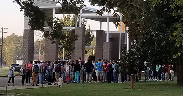 Houston High School students prayed at their flagpole