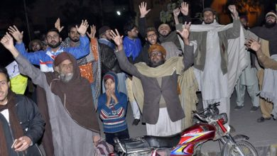 Pakistanis block a road during a protest against the acquittal of Asia Bibi