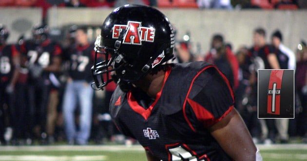 Photo of Arkansas State removing cross decal from football helmets