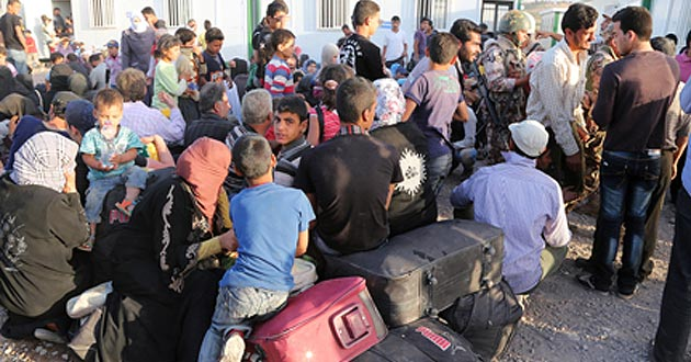 Photo of Iraqi, Syrian refugees haunted by war, loss
