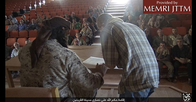 Photo of Islamic State forces Syrian Christians to sign contract