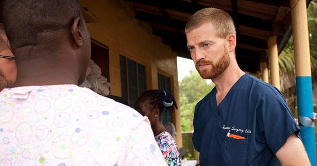 Photo of Ebola survivor Dr. Kent Brantly returning to Africa as medical missionary