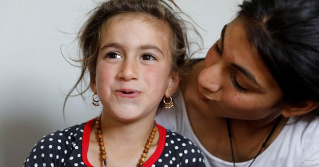 Photo of Iraqi Christian girl freed from IS says 'mum, dad' again