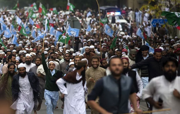 Pakistani religious groups protest against a Supreme Court decision