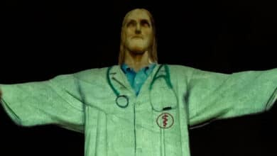 Photo of Christ the Redeemer Statue Illuminated to Look Like a Doctor